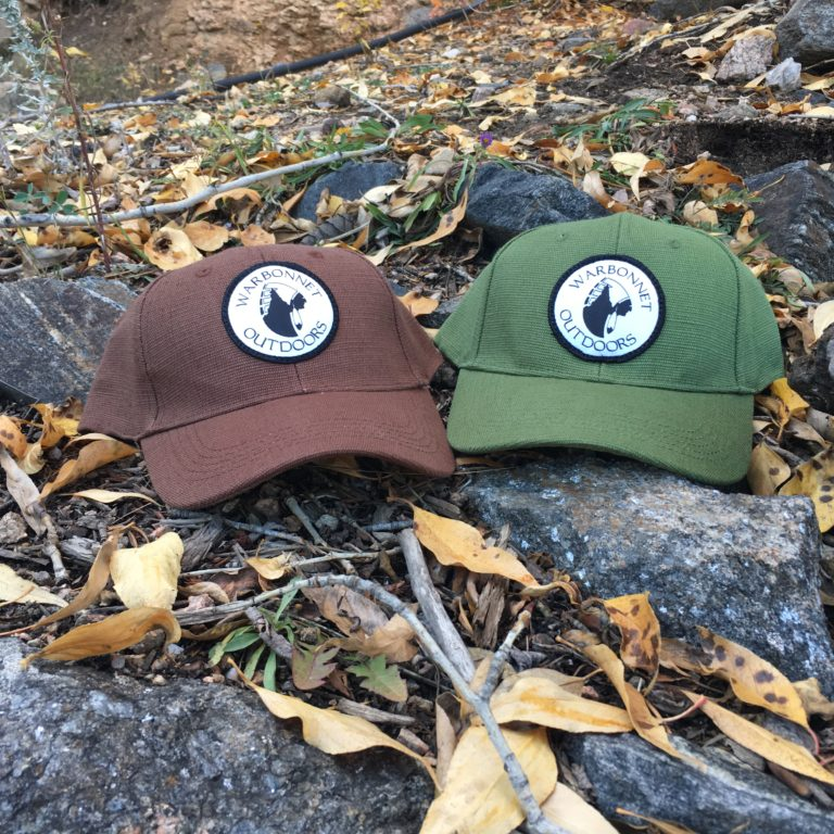 brown and green warbonnet outdoors logo hats